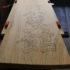 板に筆書きした古い表札(看板)を修復